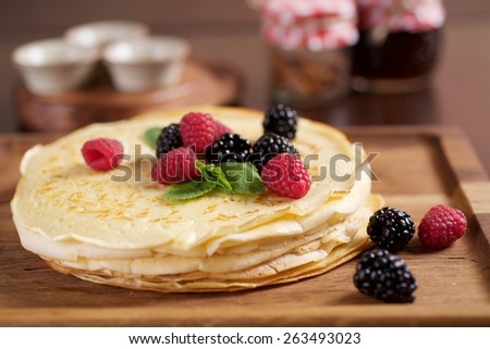 pancakes with raspberries and blackberries - stock photo