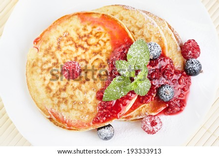 Pancakes with raspberry jam - stock photo