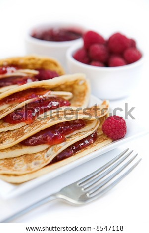 Pancakes with raspberry jam & fresh raspberries - shallow dof - stock photo