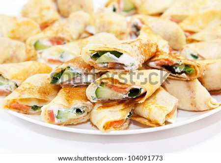 Pancakes with salmon and cheese - stock photo