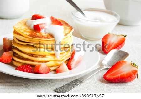 Pancakes with strawberries and cream - stock photo