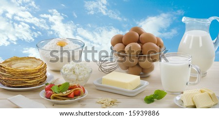 Pancakes with strawberries and dairy products - stock photo