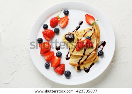 pancakes with summer berries on plate, top view - stock photo