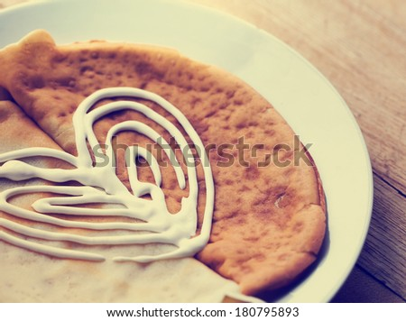 Pancakes with with heart fom sour cream closeup on a plate for pancake day - stock photo