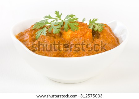 Paneer Makhani - Indian cheese cooked in a creamy sauce. - stock photo