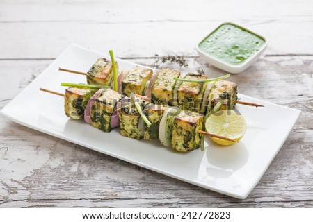 Paneer Tikka Kabab - Tandoori Indian cheese skewers - stock photo