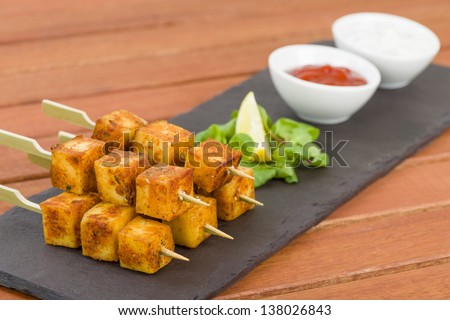 Paneer Tikka Kebab - Tandoori Indian cheese skewers served on a slate ...