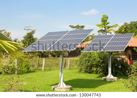 Panel of the solar batteries in the garden - stock photo