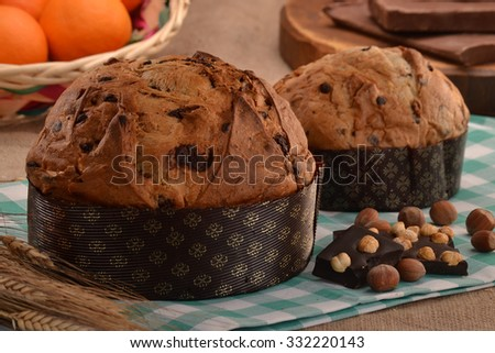 Panettone bread and ingredients on rustic wood ambient.Panetone and ingredients.Traditional christmas food. - stock photo