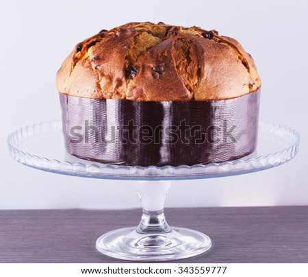 Panettone, typical Italian sweet food, over glass stand, horizontal image - stock photo