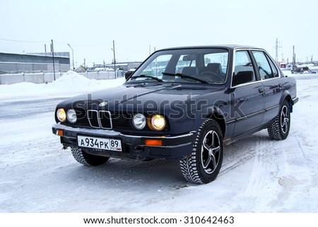 PANGODY, RUSSIA - DECEMBER 1, 2012: Motor car BMW E30 324d at the city street. - stock photo