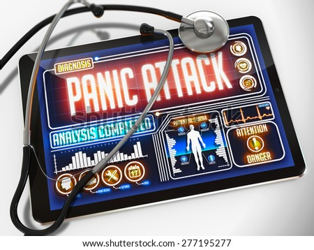 Panic Attack - Diagnosis on the Display of Medical Tablet and a Black Stethoscope on White Background. - stock photo