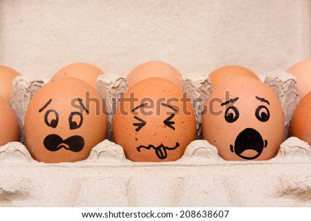 Panic face eggs in brown paper box - stock photo