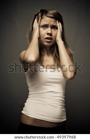 Panic girl on a grey background - stock photo