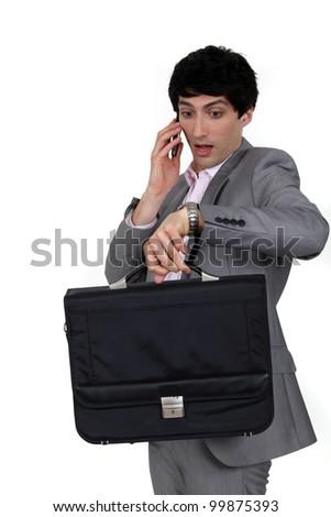 Panicked businessman - stock photo