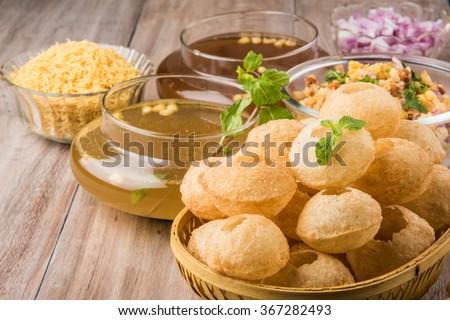 Panipuri or Gol Gappa or Chaat, Indian Street Food, Panipuri, Golgappe, Chat item, India, Stuffed Panipuri with aloo and Sweet Tamarind - Indian Food - stock photo