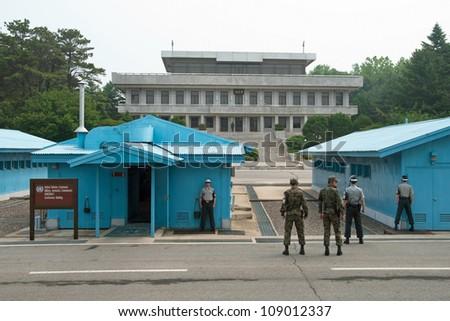 PANMUNJOM, SOUTH KOREA - CIRCA JUNE 2012: South Korean Soldiers in DMZ watching border between South and North Korea circa June 2012 in Panmunjom, South Korea. - stock photo