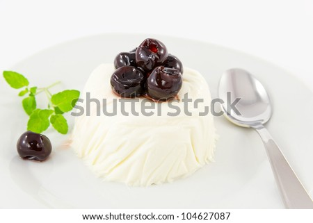 panna cotta with black cherry syrup - stock photo