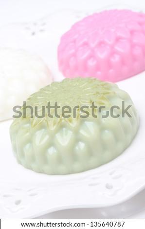Panna cotta with tea matcha on a plate closeup - stock photo