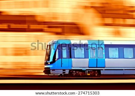 Panning blurred train on bridge - stock photo