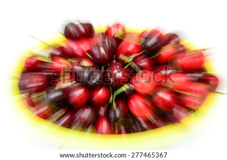 Panning of a basket of organically grown bing cherries in a local fruit market at Ellensburg, Washington, US - stock photo
