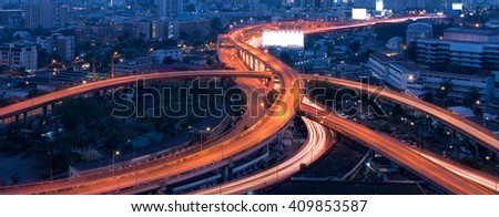 Panorama aerial view of Motorway, Expressway, Freeway the infrastructure for transportation in modern city, urban view at night time - stock photo