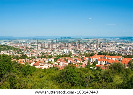 Panorama city of Clermont-Ferrand and Auvergne Volcano national park, France. - stock photo