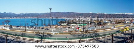 Panorama cityscapoe view of Suwa city. The city is  on the shore of Lake Suwa, in central Nagano Prefecture, Japan. - stock photo