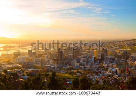 Panorama - Dawn in Cape Town (South Africa), the city center with mountains in the morning haze - stock photo