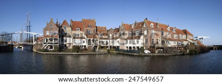 Panorama foto of old house,s  and white bridge on an blue sky in Enkhuizen. - stock photo