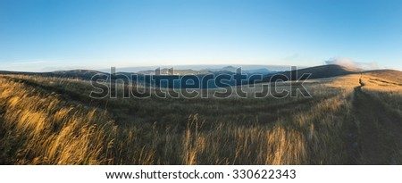 Panorama from morning grassy mountain ridge under blue sky in late summer - Greater Fatra National park, Slovakia, Europe - stock photo