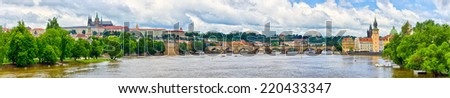 Panorama in Prague - with Charles Bridge and Hradcany hill, Czech Republic - stock photo