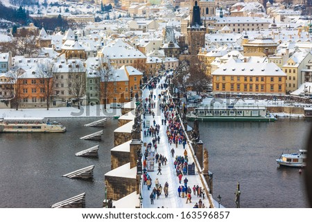 Panorama. Karlov or Charles bridge in Prague in winter - stock photo