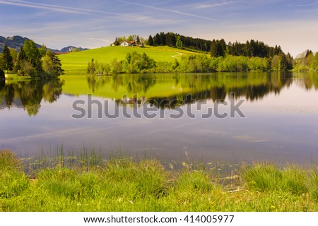 panorama landscape in Bavaria with lake and meadow - stock photo