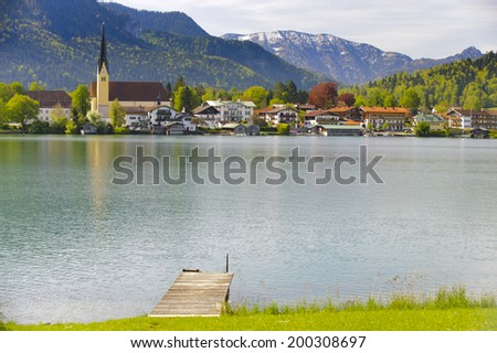 panorama landscape of lake Tegernsee in Bavaria at city Rottach-Egern and its church - stock photo