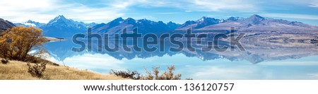 Panorama Landscape of Mountain Cook with its reflection in Lake New Zealand - stock photo