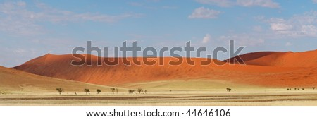 Panorama landscape of red desert sand dunes, Sossusvlei, Namibia, southern Africa - stock photo