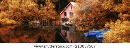 Panorama landscape stunning Autumn scene boat lake and boathouse - stock photo