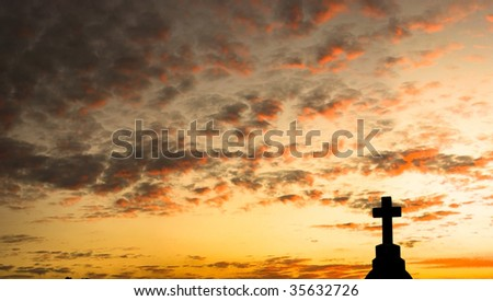 Panorama of a Cross and Clouds at Sunset - stock photo