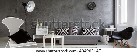 Panorama of a photographic set in a modern interior arranged in grey and white - stock photo