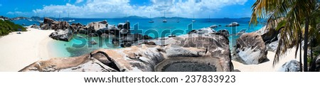 Panorama of a picture perfect beach with white sand, unique huge granite boulders, turquoise ocean water and blue sky at Virgin Gorda, British Virgin Islands in Caribbean - stock photo