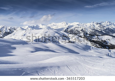 Panorama of a snow-covered slope of the Alps. Beautiful winter landscape - stock photo