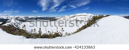 panorama of a snowy Tuolumne Meadows Yosemite High country from Gaylor Peak near Tioga Pass - stock photo