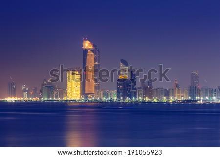Panorama of Abu Dhabi at night, capital of United Arab Emirates - stock photo