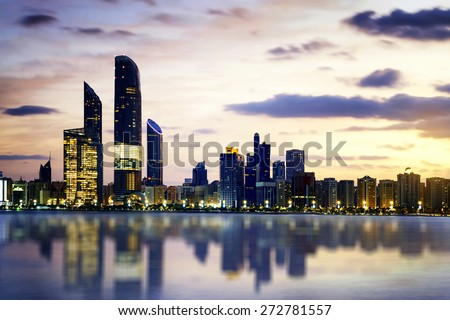 Panorama of Abu Dhabi at night, capital of United Arab Emirates  - stock photo