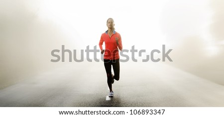 Panorama of athlete running outdoors on a road training and exercising for a marathon endurance sport. - stock photo