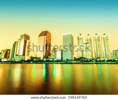Panorama of Bangkok city downtown at night with reflection of skyline, Bangkok,Thailand - stock photo