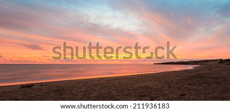 Panorama of beach at the crack of dawn (Green Gables Shore, Prince Edward Island, Canada) - stock photo