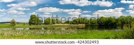 panorama of Beautiful summer rural landscape with small lagoon. Rural landscape with pond. Spring landscape. Green czech countryside. Beautiful highland vysocina european countryside - stock photo