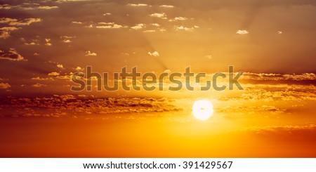 Panorama of Beautiful Sunset Sunrise. Panoramic Background. Yellow and orange warm colors of natural sunrise. Sunshine dramatic sky - stock photo